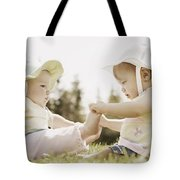 Two Girls Sit Together Tote Bag