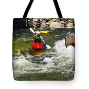 Two Kayakers On A Whitewater Course Tote Bag