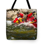 Two Men Paddling A Red Whitewater Canoe Tote Bag