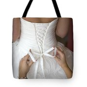 Tying The Bow On A Wedding Dress Tote Bag
