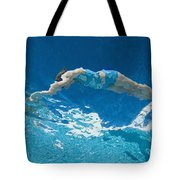 Underwater View Of Woman Diving Into Tote Bag