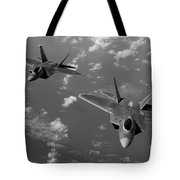 U.s. Air Force F-22 Raptors In Flight Near Guam. Tote Bag