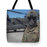 U.s. Army Soldier Stands Ready To Load Tote Bag