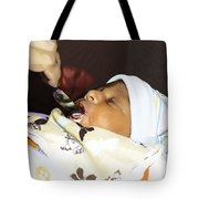 Using A Spoon To Feed A 4 Day Old Indian Baby Boy With Milk Tote Bag