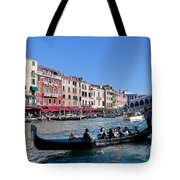Venice Italy Gondola With Tourists Floats On Grand Canal Tote Bag