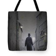 Victorian Man In Top Hat On A Cobbled Road At Night Tote Bag