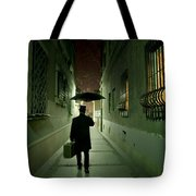 Victorian Man With Top Hat Carrying A Suitcase And Umbrella Walking In The Narrow Street At Night Tote Bag