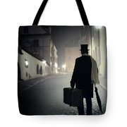 Victorian Man With Top Hat Carrying A Suitcase Walking In The Old Town At Night Tote Bag