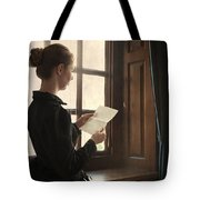 Victorian Or Edwardian Woman Reading A Letter By The Window Tote Bag