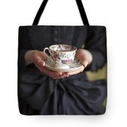 Victorian Woman Holding A China Cup And Saucer Of Tea Tote Bag