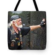 Vietnam Veteran Pays Respect To Fallen Soldiers At The Vietnam War Memorial  Tote Bag