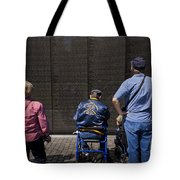 Vietnam Veterans Paying Respect To Fallen Soldiers At The Vietnam War Memorial Tote Bag