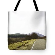 View Of Highway Running Through The Wilderness Of The Scottish Highlands Tote Bag