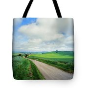 View Of Road Passing Through A Field Tote Bag