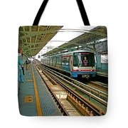 Waiting For The Sky Train In Bangkok-thailand Tote Bag