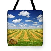 Wheat Farm Field And Hay Bales At Harvest In Saskatchewan Tote Bag