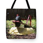 Wheel Barrow In A Yard Tote Bag by Robert D  Brozek
