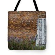White Door In Brick Building Tote Bag