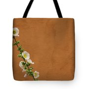 White Hollyhock Against Orange Wall Tote Bag