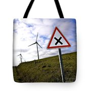 Wind Turbines On The Edge Of A Field With A Road Sign In Foreground. Tote Bag