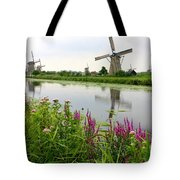 Windmills Of Kinderdijk With Wildflowers Tote Bag by Carol Groenen