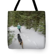 Woman And Dog Walking In Forest Tote Bag