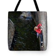 Woman Climbing Above A River Tote Bag