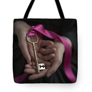 Woman Holding A Golden Key On A Pink Ribbon Tote Bag