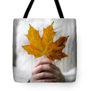 Woman Holding An Autumn Leaf Tote Bag