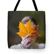 Woman Holding An Autumnal Leaf Tote Bag