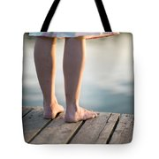 Woman In A Dress On The Edge Of A Wooden Board Walk Tote Bag