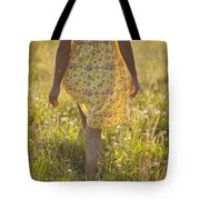 Woman In A Yellow Flowery Dress Walking In A Summer Meadow Tote Bag
