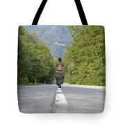 Woman On A Road Tote Bag