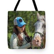 Woman Pets A Horse Tote Bag