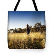 Woman Running Through Field Tote Bag