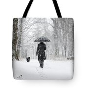 Woman Walking In A Snowy Forest Tote Bag