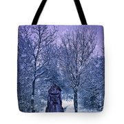 Woman Walking In Snow Tote Bag by Amanda Elwell