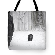 Woman Walking In The Snowy Forest Tote Bag