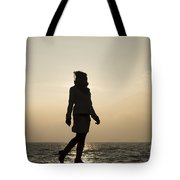 Woman Walking On The Lake Front Tote Bag