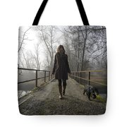 Woman Walking With Her Dog On A Bridge Tote Bag