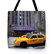 Yellow Cabs Pass In Front Of Radio City Music Hall Tote Bag