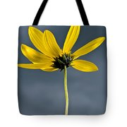 Yellow Flower Against A Stormy Sky Tote Bag