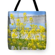 Yellow Flowers And A White Fence Tote Bag