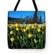 Yellow Tulips Before White Picket Fence Tote Bag