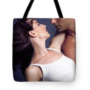 Young Couple About To Kiss Tote Bag