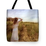 Young Lady In Vintage Clothing Watching A Biplane Tote Bag
