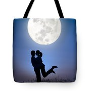 Young Lovers Embracing Before A Full Moon Tote Bag