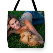 Young Woman And Golden Retriever Puppies Tote Bag