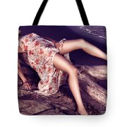 Young Woman In Dress Lying On Driftwood On A Shore Tote Bag