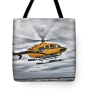 A Bell 407 Utility Helicopter Prepares Tote Bag